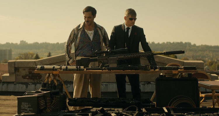 Lucky Day 2019 Movie Scene Crispin Glover as Luc and Tomer Sisley as Jean-Jacques looking at weapons at the roof of the bar