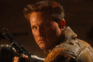 Soldier 1998 Movie Scene Kurt Russell as Todd reloading a gun