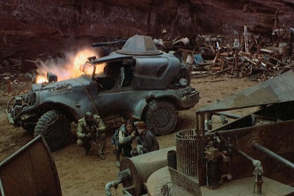 Spacehunter Adventures In The Forbidden Zone 1983 Movie Scene Our trio is attacked from above with the futuristic vehicle providing cover