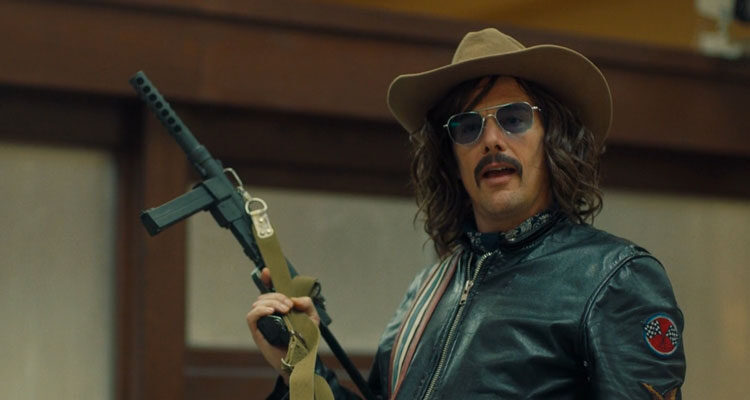 Stockholm 2018 Movie Ethan Hawke as Lars Nystrom holding a gun and wearing a cowboy hat