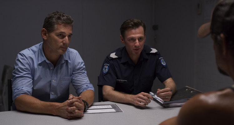 The Dry 2020 Movie Scene Eric Bana as Aaron Falk and Keir O'Donnell as Greg Raco in the interrogation room