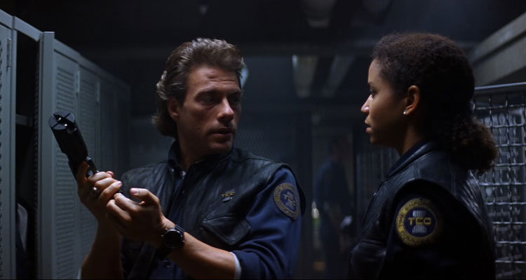 Timecop 1994 Movie Scene Jean-Claude Van Damme holding a futuristic gun and Gloria Reuben
