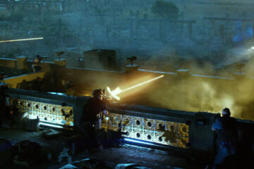 13 Hours 2016 Movie Scene Contractors firing their weapons from the top of the buildings with visible tracer rounds at a car