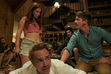 Big Bear 2017 Movie Scene Joey Kern as Joe laying on the ground about to spanked with a belt by Heidi Heaslet as Susan with Zachary Knighton as Colin