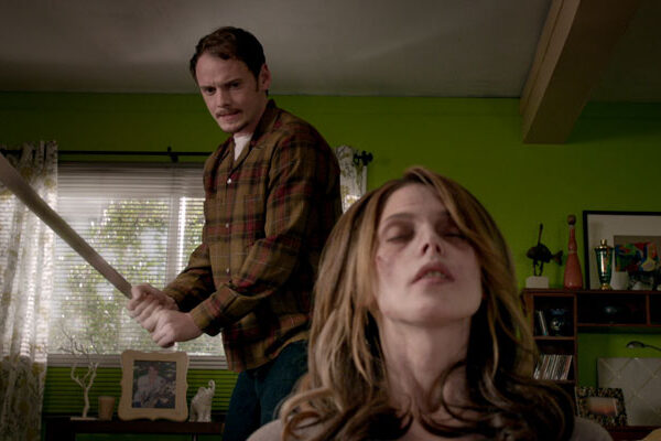 Burying the Ex 2014 Movie Scene Anton Yelchin as Max holding a machete as he about to swing at Ashley Greene as Evelyn