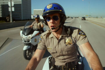 CHIPS 2017 Movie Scene Dax Shepard as Jon and Michael Peña as Ponch riding motorbikes down the highway during a chase