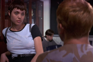 Hackers 1995 Movie Scene Angelina Jolie as Kate with short hair and wearing a t-shirt