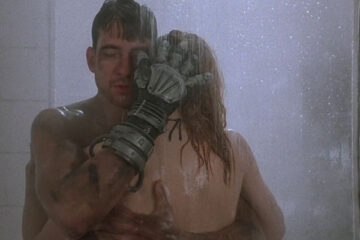 Hardware 1990 Movie Scene Dylan McDermott as Mo caressing Stacey Travis as Jill with his cybernetic hand