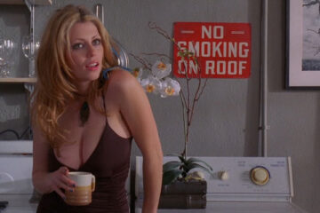 Hot Tamale 2006 Movie Scene Diora Baird as Tuesday in a revealing shirt with a big cleavage doing her laundry
