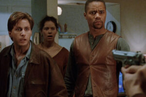 Judgment Night 1993 Movie Scene Emilio Estevez as Frank and Cuba Gooding Jr. as Mike with Angela Alvarado as Rita behind in her apartment