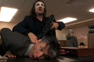 Killing Zoe 1993 Movie Scene Jean-Hugues Anglade as Eric holding a gun to hostage inside the bank