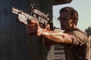 Nemesis 1992 Movie Scene Olivier Gruner holding two guns