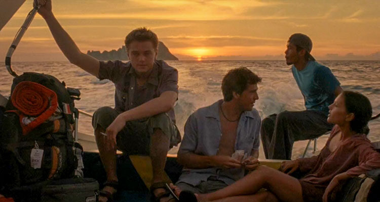 The Beach 2000 Movie Scene Leonardo DiCaprio as Richard, Virginie Ledoyen as Françoise and Guillaume Canet as Étienne on a boat travelling to a secret island of Ko Phi Phi Leh