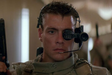 Universal Soldier 1992 Movie Scene Jean-Claude Van Damme as Luc Deveraux wearing an eye-piece and a gun