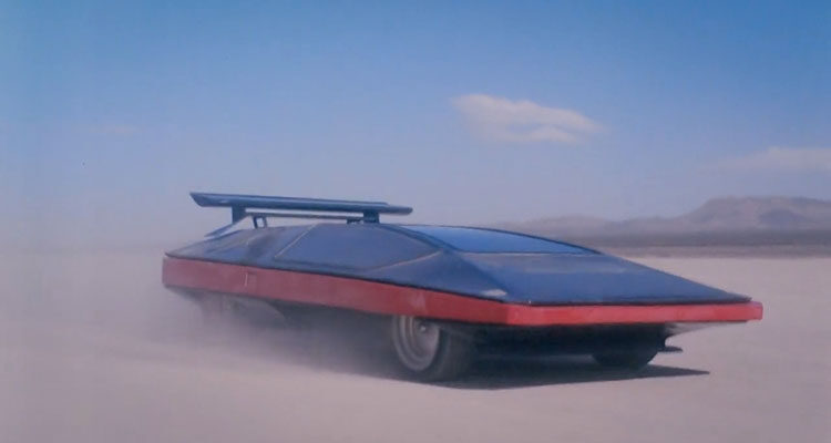 Black Moon Rising 1986 Movie Scene The prototype car Wingho Concordia II racing through the desert