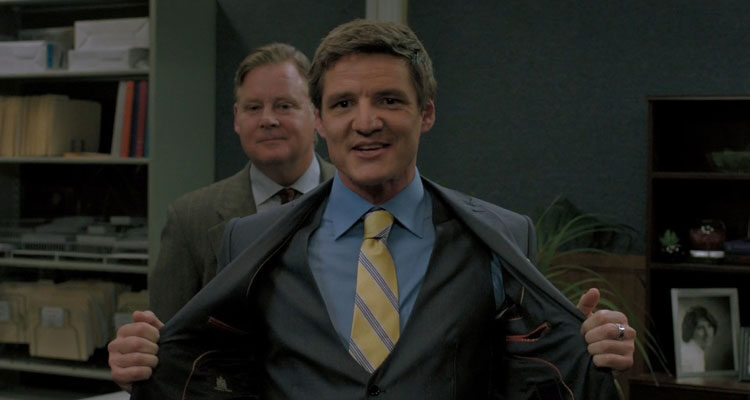 Bloodsucking Bastards 2015 Movie Scene Pedro Pascal as Max in a suit smiling with Joel Murray as Ted behind him