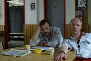 Komm, süsser Tod AKA Come Sweet Death 2000 Movie Scene Josef Hader as Simon Brenner and Simon Schwarz as Berti sitting and waiting for a call