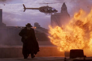 Darkman 1991 Movie Scene Liam Neeson as Peyton Westlake running away from the explosion and helicopter behind him