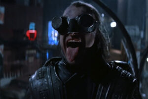 Highlander II The Quickening 1991 Movie Scene Corda, Katana's henchman with crazy welding glasses cackling as he's looking at an explosion