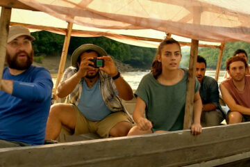 The Green Inferno 2013 Movie Scene Lorenza Izzo as Justine, Daryl Sabara as Lars and Nicolás Martínez as Daniel riding a boat down the river with others and admiring the nature