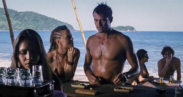 Turistas 2006 Movie Scene Josh Duhamel as Alex and Melissa George as Pru ordering drinks at the beach bar in Brazil