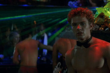 54 1998 Movie Scene Ryan Phillippe as Shane O'Shea shirtless and wearing just a bow tie behind the bar