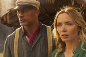 Jungle Cruise 2021 Movie Scene Dwayne Johnson as Frank Wolff and Emily Blunt as Lily Houghton aboard his boat