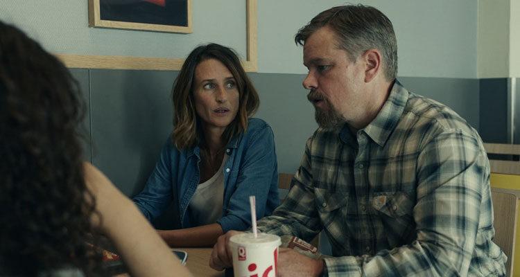Stillwater 2021 Movie Scene Matt Damon as Bill Baker and Camille Cottin as Virginie talking to two girls in a cafe