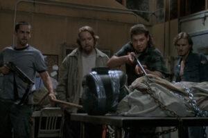 Altered 2006 Movie Scene Adam Kaufman as Wyatt, Brad William Henke as Duke, Michael C. Williams as Otis and Paul McCarthy-Boyington as Cody looking at the captured alien