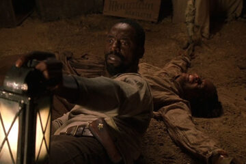 Dead Birds 2004 Movie Scene Isaiah Washington as Todd laying on the ground in the barn and holding a gun