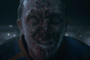 Goal of the Dead 2014 Movie Scene Football player turned into a zombie foaming at the football field