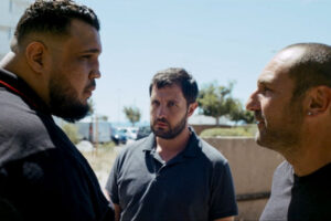 The Stronghold AKA BAC Nord 2020 Movie Scene Gilles Lellouche as Greg Cerva and Karim Leklou as Yass arguing with a huge gang boss