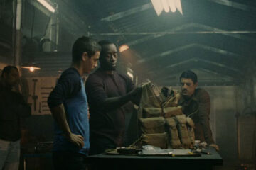 Traitor 2008 Movie Scene Don Cheadle as Samir Horn and Saïd Taghmaoui as Omar giving a young kid a suicide vest