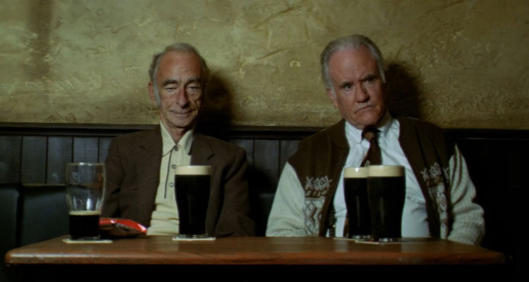 Waking Ned Devine 1998 Movie Scene Ian Bannen as Jackie O'Shea and David Kelly as Michael O'Sullivan drinking beer in a pub