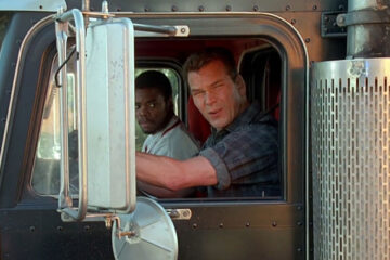 Black Dog 1998 Movie Scene Patrick Swayze as Jack Crews and Gabriel Casseus as Sonny looking at an exposion