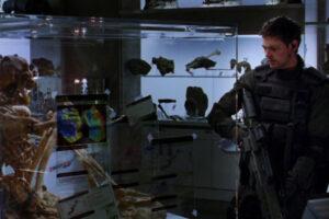 Doom 2005 Movie Scene Karl Urban as John Grimm looking at the skeletal remains in the lab