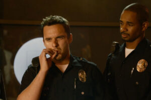 Lets Be Cops 2014 Movie Scene Jake Johnson as Ryan smoking a joint dressed as a cop with Damon Wayans Jr. as Justin looking at him