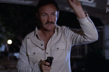 Night Moves 1975 Movie Scene Gene Hackman as Harry Moseby holding a gun on a boat